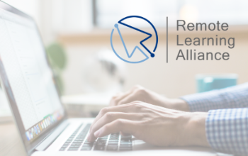 Person working on a laptop with the logo of the Remote Learning Alliance in the upper right corner