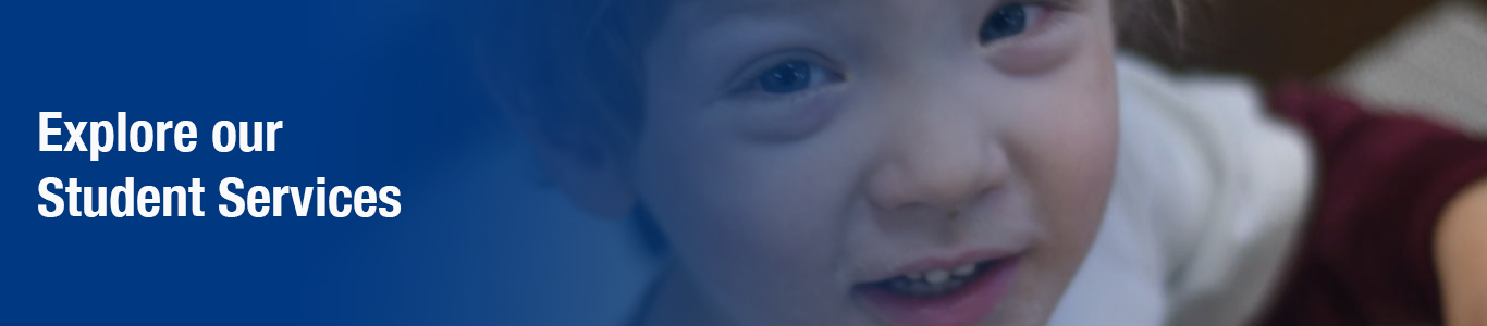 "young boy looking at camera smiling. blue gradient with white text: ""Explore our Student Services"""